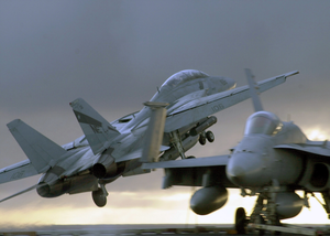 A F-14d Tomcat Assigned To The  Bounty Hunters  Of Fighter Squadron Two (vf-2) Launches From The Aircraft Carrier Uss Constellation (cv 64) For An Evening Training Flight. Image