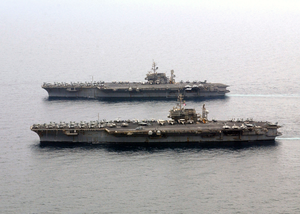 The Aircraft Carriers Uss Constellation (cv 64) And Uss Kitty Hawk (cv 63) Steam Alongside One Another. Image
