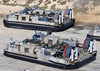 Landing Craft Air Cushion (lcac) Vehicles From Assault Craft Unit Five (acu-5), Loaded With Elements Of The 1st And 3rd Light Armored Reconnaissance (lar) Units. Image