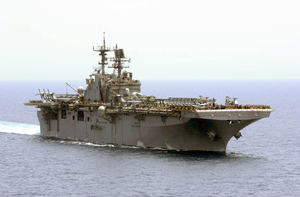 The Amphibious Assault Ship Uss Iwo Jima (lhd 7) Cruises Through The Arabian Gulf Behind Uss Nimitz (cvn 68). Image