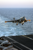 An Ea-6b Prowler Assigned To The Patriots Of Electronic Attack Squadron One Four Zero (vaq-140) Approaches The Flight Deck Of Uss George Washington (cvn 73) During Evening Flight Operations. Image