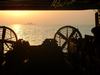 The Sunrises Behind A Landing Craft Air Cushion (lcac) During Well Deck Operations Aboard Uss Peleliu (lha 5), Lead Ship For Expeditionary Strike Group One (esg-1). Image