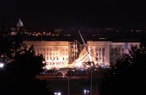 Flag On The Side Of The Pentagon At Night Image