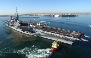 The Decommissioned Aircraft Carrier Midway Makes Its Way Across The San Diego Bay To Its Final Resting Place At Navy Pier Where It Will Become The Largest Museum Devoted To Carriers And Naval Aviation. Image