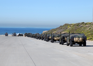 Elements Of The 1st And 3rd Light Armored Reconnaissance (lar) Units Line Up To Be Loaded On To Landing Craft Air Cushion (lcac) Vehicles. Image