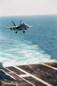 An F/a-18c Hornet, Assigned To Strike Fighter Squadron One One Three (vfa-113), Prepares To Land On The Flight Deck Of The Aircraft Carrier Uss Abraham Lincoln Image