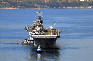 Uss Iwo Jima (lhd 7) Is Assisted By Tugs As She Arrives For A Port Visit At The Port Of Souda Bay. Image