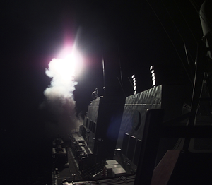 He Super Structure Of The Destroyer Gonzalez Becomes Visible In The Pitch Black Early Morning Hours, As A  Tomahawk  Cruise Missile Launches From The Aft (rear) Missile Deck Image