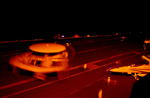 An E2-c Hawkeye Assigned To The Seahawks Of Carrier Airborne Early Warning Squadron One Two Six (vaw-126) Maneuvers For A Night-time Catapult Launch Off The Flight Deck Image