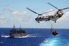 A Ch-46d Sea Knight  Lifts A Full Load From The Aircraft Carrier Uss Carl Vinson (cvn 70) To The Fast Combat Support Ship Uss Sacramento (aoe 1), While The Guided Missile Cruiser Uss Antietam (cg 54) Follows Close Behind Image