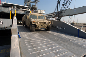 United States Army Vessel (usav) Theater Support Vessel-1x (tsv-1x) Offloads A High Mobility Multipurpose Wheeled Vehicle Image