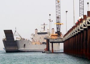 A U.s. Army Logistics Support Vessel (lsv) Pulls Alongside The U.s. Navy Elevated Causeway System-modular (elcas-m) For Equipment Offload During Continued Joint Logistics Over The Shore (jlots) Operations Image
