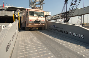 United States Army Vessel (usav) Theater Support Vessel Spearhead (tsv-1x) Off-loads An Army Fire-fighting Vehicle While Pier-side At A Port Within The Central Command Aor. Image