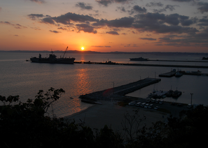 The 7th Fleet Command And Control Ship Uss Blue Ridge (lcc 19) Sits Moored In Port As The Sun Sets At U.s. Naval Facility White Beach, Okinawa, Japan. Image