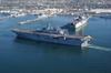 Sailors Aboard Uss Bonhomme Richard (lhd 6)  Man The Rails  As The Amphibious Assault Ship Heads To Sea Image