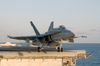 F/a-18c Hornet Launches From One Of Four Steam Powered Catapults On The Ship S Flight Deck Image