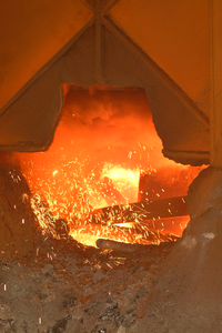 Molten Steel, Recycled From The World Trade Center, Glows Red As It Is Melted In A Cauldron At The Amite Foundry Image