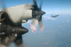 An Italian Air Force F-16 Fighter Intercepts A U.s. Navy P-3c Orion. Image