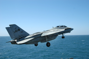 An F-14d Tomcat Assigned To The  Tomcatters  Of Fighter Squadron Three One (vf-31) Launches From The Flight Deck Aboard The Aircraft Carrier Uss Abraham Lincoln (cvn 72) Image