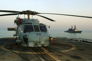 An Sh-60  Sea Hawk  Helicopter Rests On The Fantail Of The Mobile Bay Image