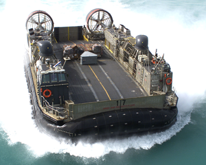Landing Craft Air Cushion Seventeen (lcac 17) Approaches The Well Deck Of The Amphibious Assault Ship Uss Saipan (lha 2). Image