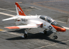 A T-45c Goshawk Makes An Arrested Landing On The Flight Deck. Image