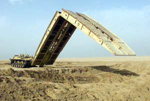 An M60a1 Armored Vehicle Landing Bridge (avlb) Practices The Deployment Of Its 60 Foot Bridge Span Image
