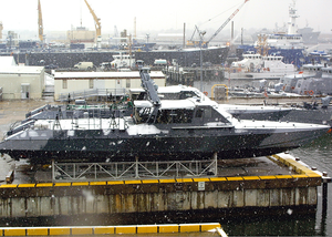 Two Mark 5 Special Operations Craft Assigned To Naval Special Warfare Group Four (nswg-4) Special Boat Team Twenty (sbt-20) Slowly Accumulate The Falling Snow During The Region Image