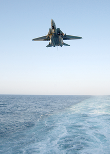 An F-14d Tomcat  Assigned To The Tomcatters Of Fighter Squadron Thirty One (vf-31) Prepares To Land On The Ship S Flight Deck. Image