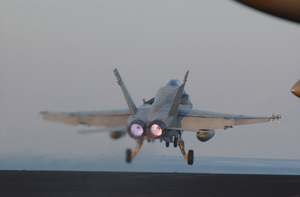 An F/a-18c Hornet Assigned To The  Argonauts  Of Strike Fighter Squadron One Four Seven (vfa-147) Launches From One Of Four Steam Driven Catapults During Flight Operations Aboard Uss Carl Vinson (cvn 70). Image