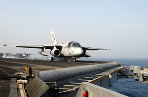 An S-3b Viking Aunches From The Flight Deck Aboard Uss Harry S. Truman (cvn 75) As Another S-3b Viking Prepares To Launch Image