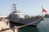 The U.s. Navy Patrol Boat Uss Firebolt (pc 10) Sits Moored In Port Displaying The Image
