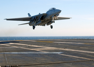 An F-14d  Tomcat  From The  Black Lions  Of Fighter Squadron Two One Three (vf-213) Lands On The Ship S Flight Deck After A Training Mission. Image