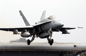 An F/a-18 Hornet Launches From The Flight Deck Aboard The Aircraft Carrier Uss Kitty Hawk (cv 63) Image