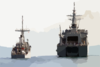 The Mine Countermeasures Ship Uss Patriot (mcm 7) Completes Fuel Connections While Preparing To Take On Fuel From The Japanese Minesweeper Tender Jds Bungo (mst 464) During An Underway Replenishment (unrep) Operation. Clip Art