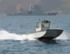 A Naval Support Activity Patrol Boat Keeps Watch Over Harbor Activities In Souda Bay, Crete, Greece Clip Art