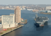 The Nuclear Powered Aircraft Carrier Uss George Washington (cvn 73) Passes Downtown Norfolk, Va. During Her Transit Down The Elizabeth River From Norfolk Naval Station To Norfolk Naval Shipyard In Portsmouth, Va. Clip Art