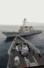 The Guided Missile Destroyer Uss John S. Mccain (ddg 56) Closes In On The Bow Of The Guided Missile Cruiser Uss Vincennes (cg 49), Commencing A Towing Exercise. Clip Art