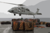 Storekeepers Assigned To The Aircraft Carrier Uss Kitty Hawk (cv 63) Supply Department S Stock Control Division, Hook Up Palletized Cargo To An Mh-60s Knighthawk Helicopter. Clip Art