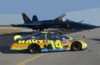 The Navy Sponsored Chevrolet Monte Carlo Busch Series Race, Show Car Is Parked On The Tarmac Near F/a-18 Hornets Assigned To The Navy S Flight Demonstration Team, The Blue Angels, At Sherman Field Onboard Nas Pensacola. Clip Art