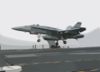 An F/a-18 Hornet Assigned To The Checkerboards Of Marine Strike Fighter-attack Squadron Three One Two (vmfa-312) Lands On The Flight Deck Aboard Uss Enterprise (cvn 65). Clip Art