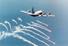 A P-3c  Orion  Attached To Patrol Squadron 45 (vp-45) Fires Self-defensive Flares In Preparation For An Over Land  Electro-optical (eo) Surveillance Mission In Bosnia-herzegovina Image