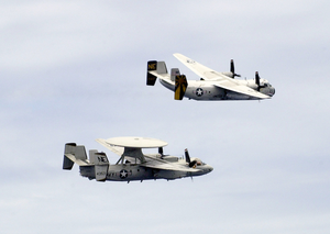 An E-2c Hawkeye And A C-2a Greyhound Make A Fly-by Over The Uss Constellation (cv 64) During Practice For Constellation Image