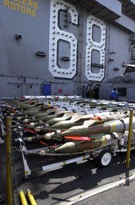 Ordnance Is Inspected Prior To Being Loaded Onto Aircraft Image