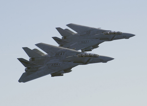 A Pair Of F-14d Tomcats Assigned To The  Bounty Hunters  Of Fighter Squadron Two (vf-2) Conduct A Fly-by Of The Aircraft Carrier Uss Constellation (cv 64). Image