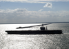 The Uss George Washington (cvn 73), Sails Past The Chesapeake Bay Bridge Tunnel On The Way To Sea, As It Prepares For The Composite Training Unit Exercise (comptuex) In The Atlantic Ocean Image
