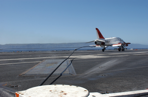A T-45c Goshawk Catches One Of Four Arresting Wires As It Lands On The Flight Deck Of Uss John C. Stennis (cvn 74) Image
