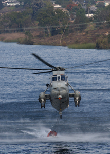 A Uh-3h Sea King Helicopter Loads Its Bambi Bucket Image
