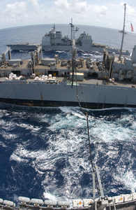 The Guided Missile Cruiser Uss Antietam (cg 54) Pulls Alongside The Fast Combat Support Ship Uss Sacramento (aoe 1) While Conducting An Underway Replenishment Image