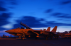An F-14  Tomcat  Assigned To The  Swordsmen  Of Fighter Squadron Three Two (vf 32) Stands Ready For Evening Flight Operations Image